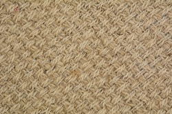 Brown woven synthetic carpet pattern macro for texture or background
