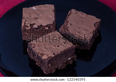 Brownie on the black dish