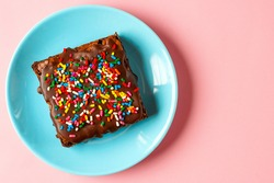 Brownie with chocolate frosting and sprinkles