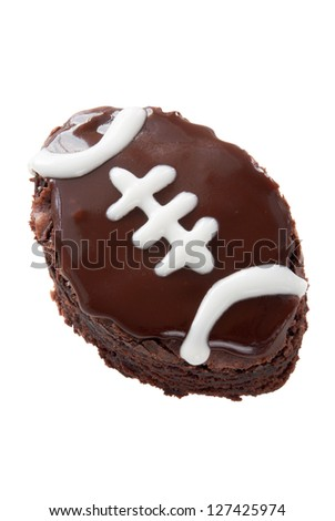 ... dark chocolate icing and white piping. Isolated on white background