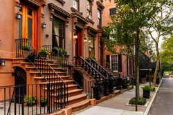 Brownstone facades & row houses at sunset in an iconic neighborhood of Brooklyn Heights in New York City