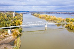 Brownville Bridge over the Missouri River on U.S. Route 136  from Nemaha County, Nebraska, to Atchison County, Missouri, at Brownville, Nebraska, aerial view in fall scenery with flooded river.