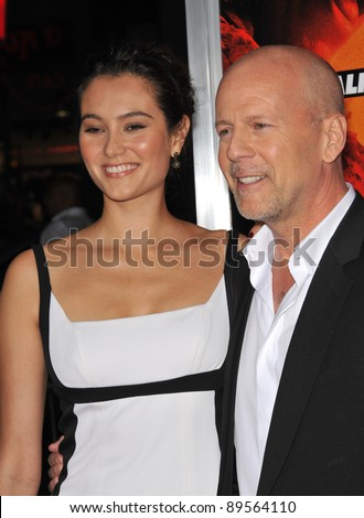 """Bruce Willis & wife Emma Heming at the premiere of his new movie """"Red"""" at Grauman's Chinese Theatre, Hollywood. October 11, 2010  Los Angeles, CA Picture: Paul Smith / Featureflash"""
