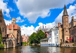 Bruges, Belgium. Image with Rozenhoedkaai in Brugge, Dijver river canal with Belfort (Belfry) tower. Flanders landmark.