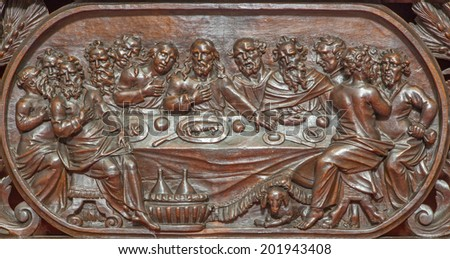 BRUGES, BELGIUM - JUNE 13, 2014: The carved relief of the Last supper of Jesus  in Karmelietenkerk (Carmelites church)  by carmelite Victor van de Heilige Jacob fromk 17. cent.