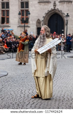 BRUGES, BELGIUM - MAY 17: Annual Procession of Holy Blood on Ascension Day. Locals perform  dramatizations of Biblical events - Moses with Ten Commandments. May 17, 2012 in Bruges (Brugge), Belgium