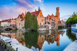Bruges, Belgium. The Rozenhoedkaai canal in Bruges with the Belfry in the background.