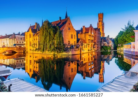 Bruges, Belgium. The Rozenhoedkaai canal in Bruges with the Belfry in the background. Сток-фото ©