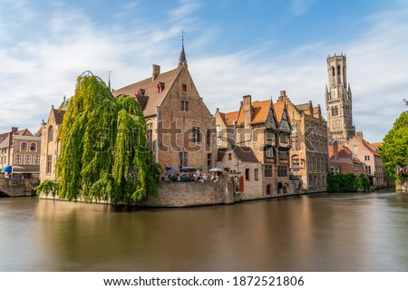 Bruges, Belgium. The Rozenhoedkaai canal in Bruges with the Belfry in the background Stock photo ©