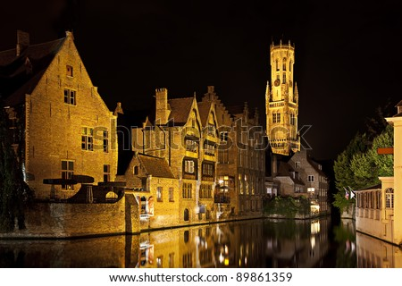 Bruges canal with Belfort tower at night, Belgium