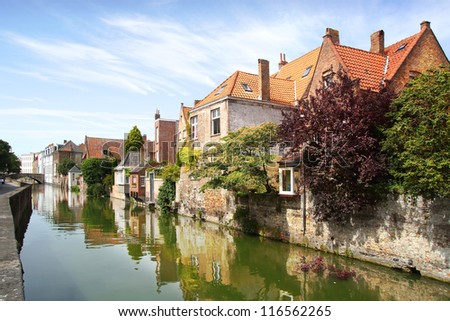 BRUGGE, BELGIUM - AUGUST 07: Historic Centre of Brugge. Bruges is unique, in the sense that here combination of old, not so old and new houses fascinates; August 07, 2012 in Brugge, Belgium