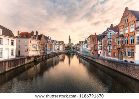 Brugge cityscape. Bruges skyline. Historic street and water channel in Brugge. Belgium.