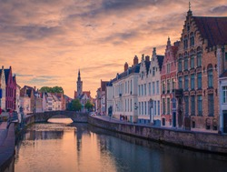 Brugge evening cityscape. Old buildings at water channel in Bruges, Belgium.