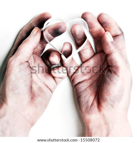 stock photo : bruised hands holding a heart