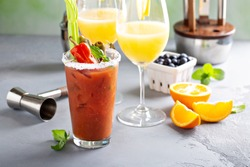 Brunch cocktails with orange mimosas and bloody mary