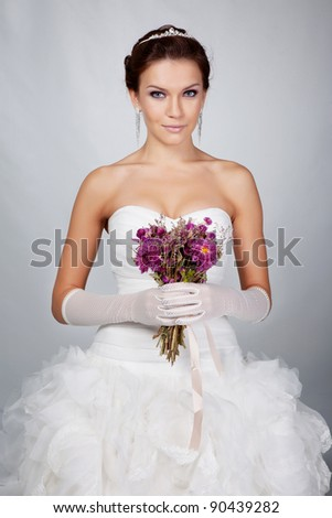 Brunet bride portrait in studio - stock photo