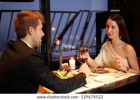 Brunette and young guy met at a restaurant for dinner