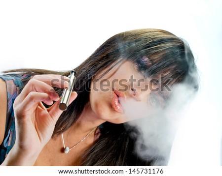 brunette beautiful girl smoking electronic cigarette