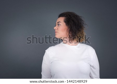 Brunette brunette girl happy face smiling with crossed arms looking confident at the camera standing against gray wall. Positive person. #1442148929