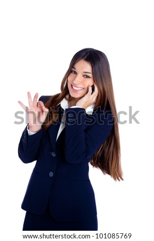 brunette business woman talking mobile phone happy smiling with blue suit on white