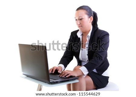 Brunette business woman working on the laptop