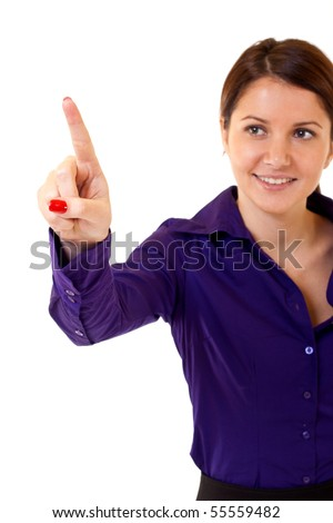 Brunette businesswoman touching virtual pad transparent key with finger