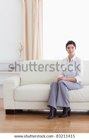 Brunette businesswoman waiting in a living room
