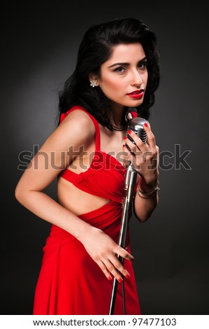 Brunette chanteuse in a vintage red dress