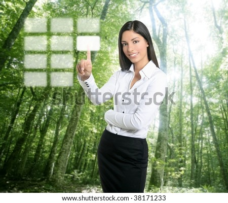 Brunette ecological businesswoman touching transparent key pad, ecology symbol