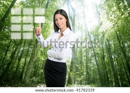 Brunette ecological businesswoman touching transparent key pad, ecology symbol [Photo Illustration]