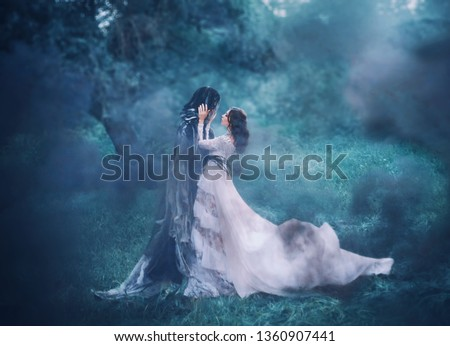 Photo of  brunette girl ghost and spirit of nightly mysterious cold blue forest, lady in white vintage lace dress with long flying train hugs dark terrible death god, lost sinful soul in thick fog, black smoke