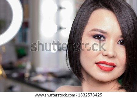 brunette girl has red lips, makeup face #1332573425