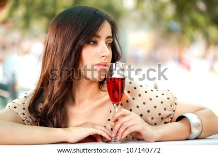 brunette girl with a glass of wine - stock photo