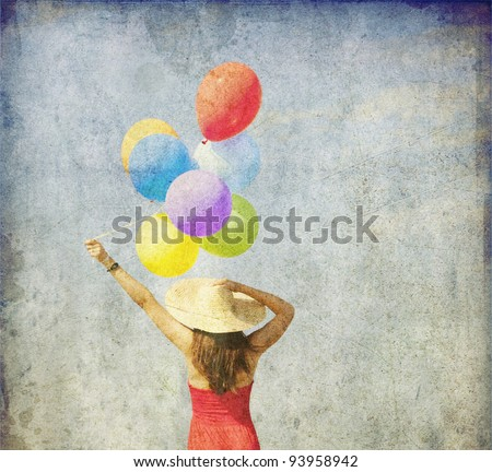 Brunette girl with colour balloons at blue sky background. Photo in old image style.
