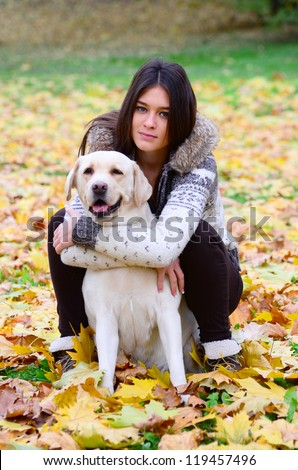 Brunette girl with dog in nature