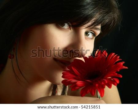 Brunette girl with red flower