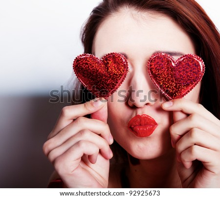 Brunette girl with red hearts isolated on white