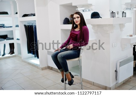 Brunette gorgeous girl in the clothing store boutique at casual clothes. #1122797117