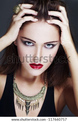 Brunette model touching head, high end fashion portrait