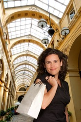 Brunette shopping in an old Parisian gallery
