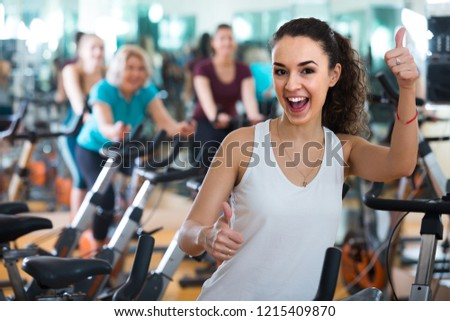 Free photos smiling spanish adults in gym working out at group