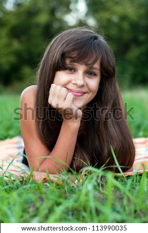Brunette teen girl on nature - stock photo