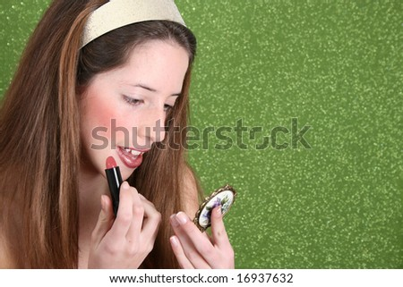 Brunette teenager on a green background wearing a broad head band