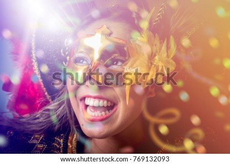 Brunette wearing carnival costume #769132093