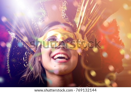 Brunette wearing carnival costume #769132144