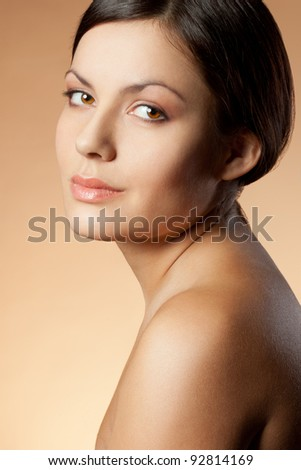 brunette woman face vertical portrait over skintone background