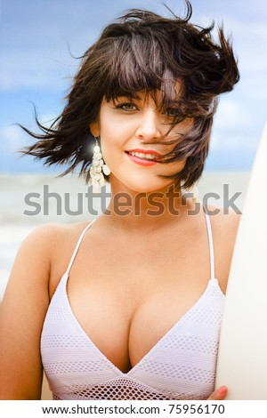 Brunette Woman Half Body Portrait With Wind Blowing In Hair While Holding A Surf Board In An Image Of Happiness And Recreation Living The Outdoors Lifestyle