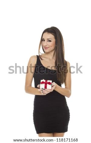 Brunette woman holding gift box over white