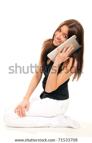 Brunette woman holding new electronic tablet touch pad computer and talking as cellular mobile phone, holding and listening, fun picture isolated on white background