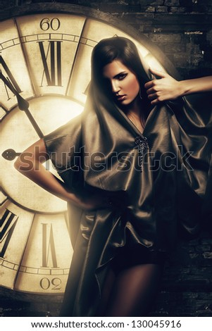 brunette woman in cape at clock